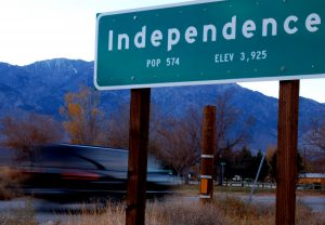 Population sign on Highway 395 leading into Independence, CA.